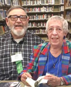 Ford and Irene signing their books